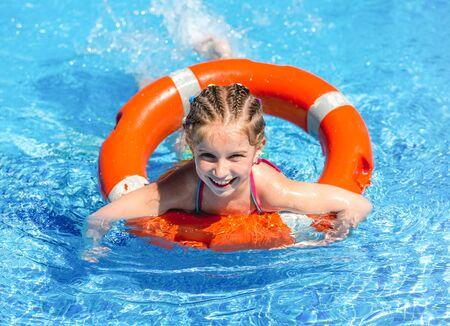 happy little girl in a wetsuit