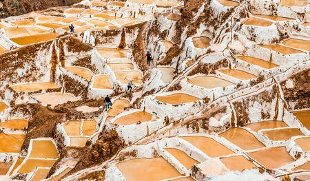 salt extraction in Peru. Workers at Salinas de Maras 写真素材