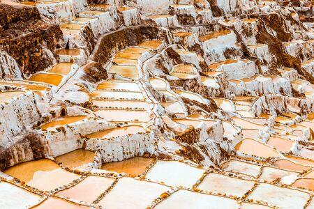 salt extraction in Peru at Salinas de Maras 写真素材