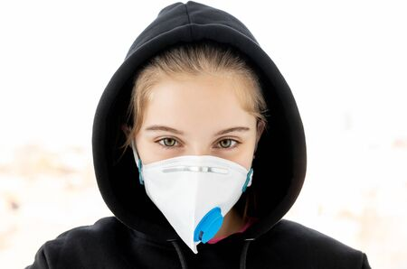 Girl in protective facial mask