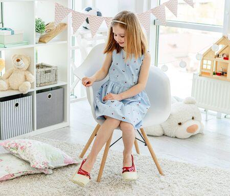 Little girl in moms heel shoes