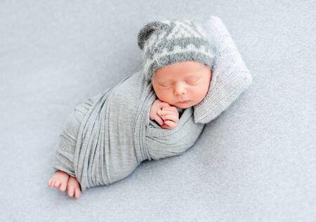 Cute newborn sleeping on tiny pillow 免版税图像