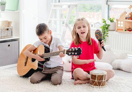 Cute children playing musical instruments 免版税图像