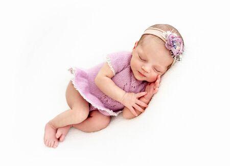 Sleeping newborn baby girl