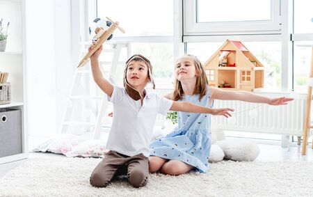 Happy kids playing with plane model