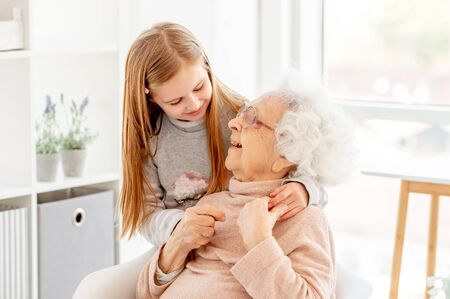 Lovely aged woman and little girl
