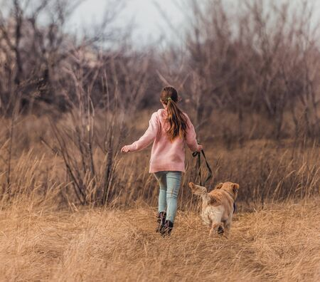 Cheerful girl with active dog
