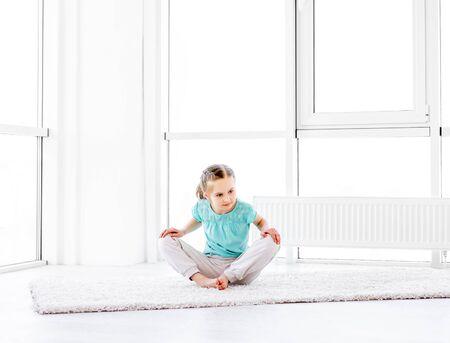 Little girl doing workout 免版税图像