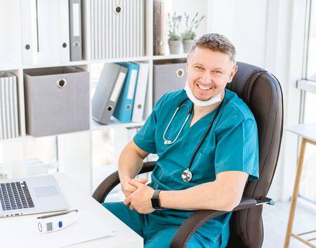 Smiling doctor in light office