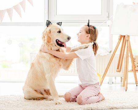 Cheerful little girl with cute dog 免版税图像