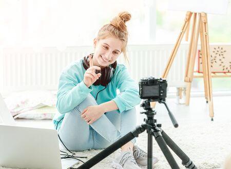 Happy teenage girl shooting vlog 免版税图像