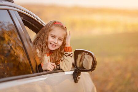 Nice girl looking from car 免版税图像