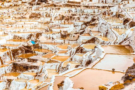salt extraction in Peru. bags with salt at Salinas de Maras 免版税图像