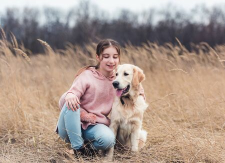 Beautiful girl with dog outside