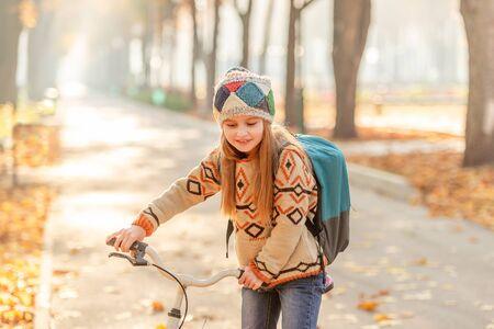 Bicycle girl riding to school 免版税图像