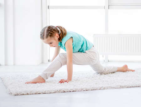 Little gymnast performing twine