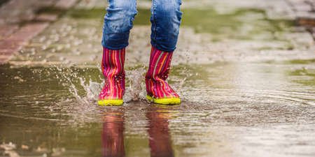 Girls legs in cute rubber boots Imagens