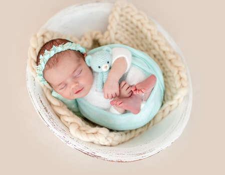 Charming smile of sleeping newborn Foto de archivo