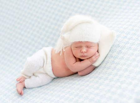 Charming newborn with pillow under head Foto de archivo
