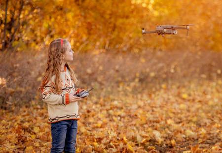 Cute little girl controlling drone Foto de archivo