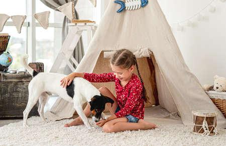 Little girl with fox terrier dog