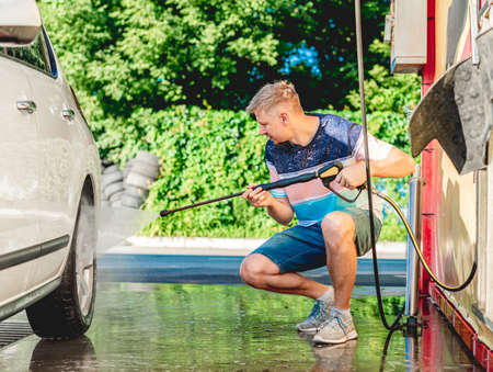 Washing car with high pressure water Foto de archivo - 152201467