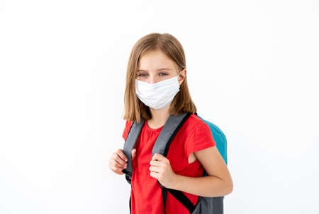 School girl in medical face mask 스톡 콘텐츠