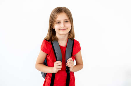 Portrait of school girl with backpack