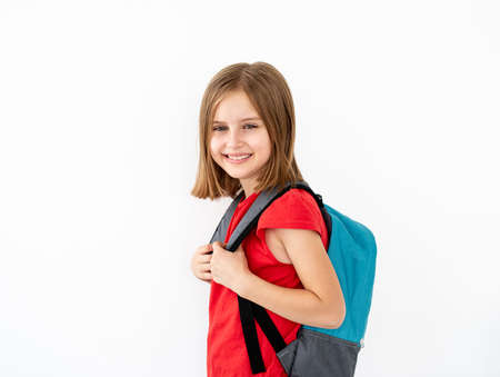 Little girl with backpack standing sideways 스톡 콘텐츠 - 152955836