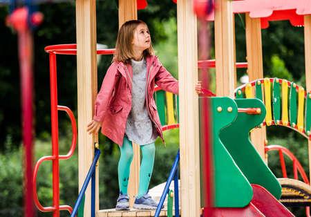 Girl kid playing on park playground