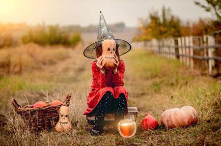 Little girl in halloween costume on nature