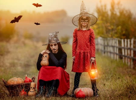 Children dressed for halloween with festive decorations