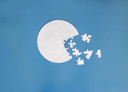 white round shaped jigsaw puzzle on blue