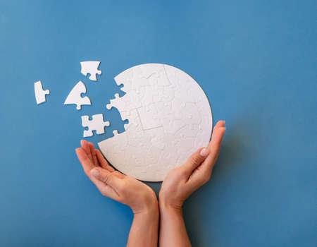 Jigsaw puzzle in shape of globe
