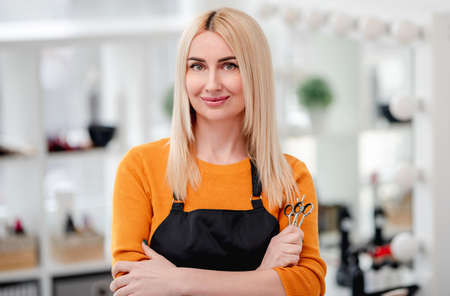 Portret of hairdresser in salon