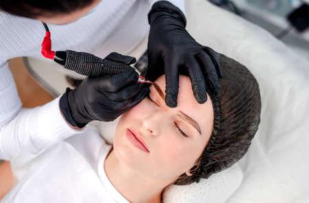 Master making eyebrows permanent makeup