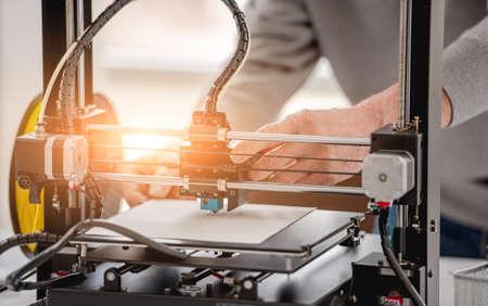 Man with 3D printer