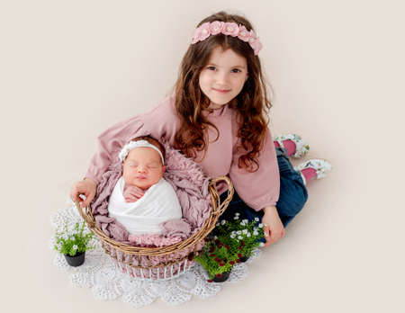 Girl with her newborn sister