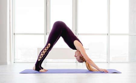 Blond woman practicing yoga