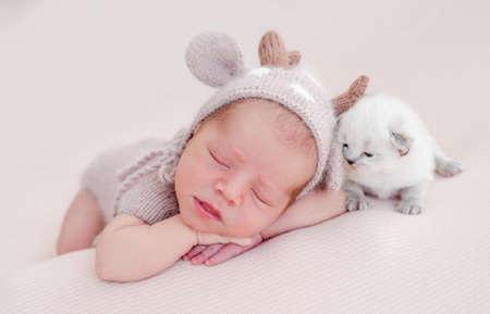 Newborn sleeping with kitten