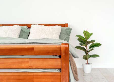 Wooden bed in interior Archivio Fotografico