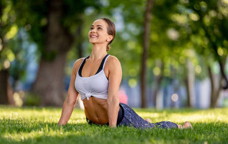 Girl doing yoga at nature