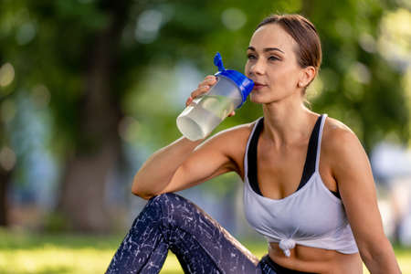 Girl with water during yoga