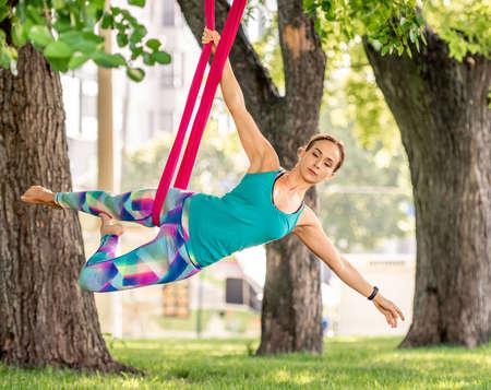 Girl doing fly yoga