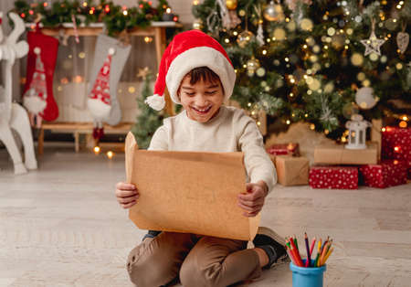 Little boy with letter to santa