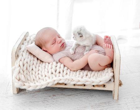 Newborn with kittens