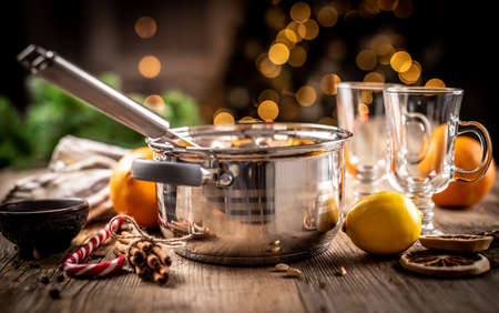 Steel pot and ingredients for mulled wine