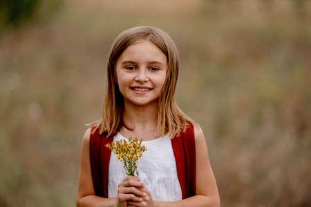 Preteen girl in the field