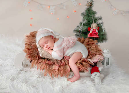 Newborn sleeping on tiny bed