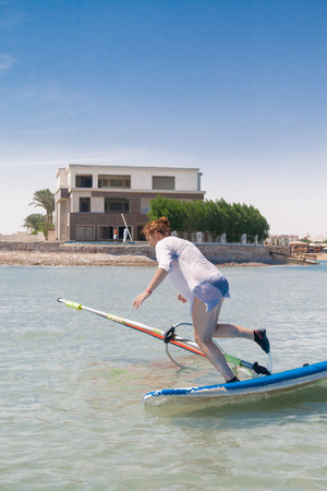 sail board: Young woman falls off the board for windsurfing in Egypt, Hurghada